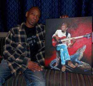 "Rggie Washington posing with his painting at ""Duc des Lombards"" (France)"